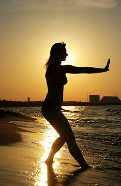 Silhouette of a woman practicing qigong