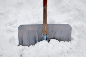 A snow shovel in a pile of snow