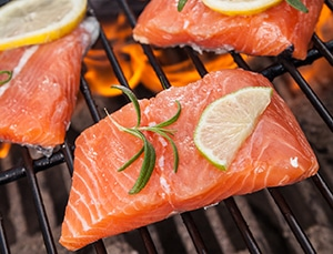 Salmon steaks cooking on the grill