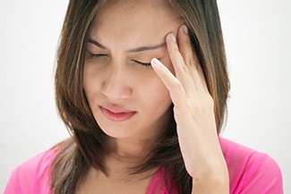 Woman with a throbbing migraine