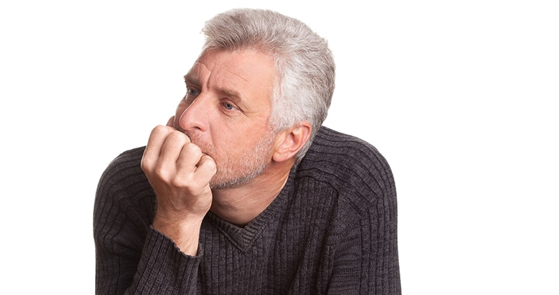 Older man having trouble thinking