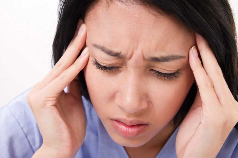 woman suffering from a migraine headache