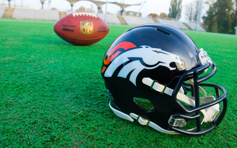 Denver Broncos helmet sitting on field