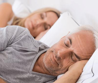 A peacful couple sleeping without the distraction and snoring of sleep apnea