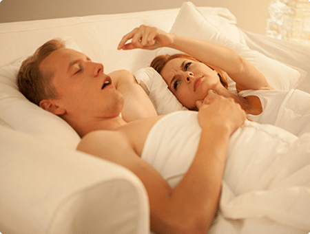 A snoring man is keeping his wife awake because of his sleep apnea