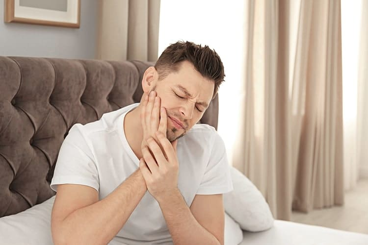 If you wake up with a sore jaw in the morning like this man, it could be linked to sleep apnea