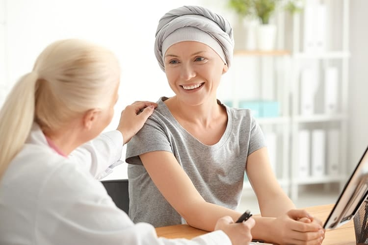 Woman after chemotherapy visit with a doctor after treatment. Cancers that women are prone to might respond more to oxygen shortage, like in sleep apnea.