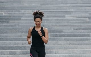 woman jogging down steps