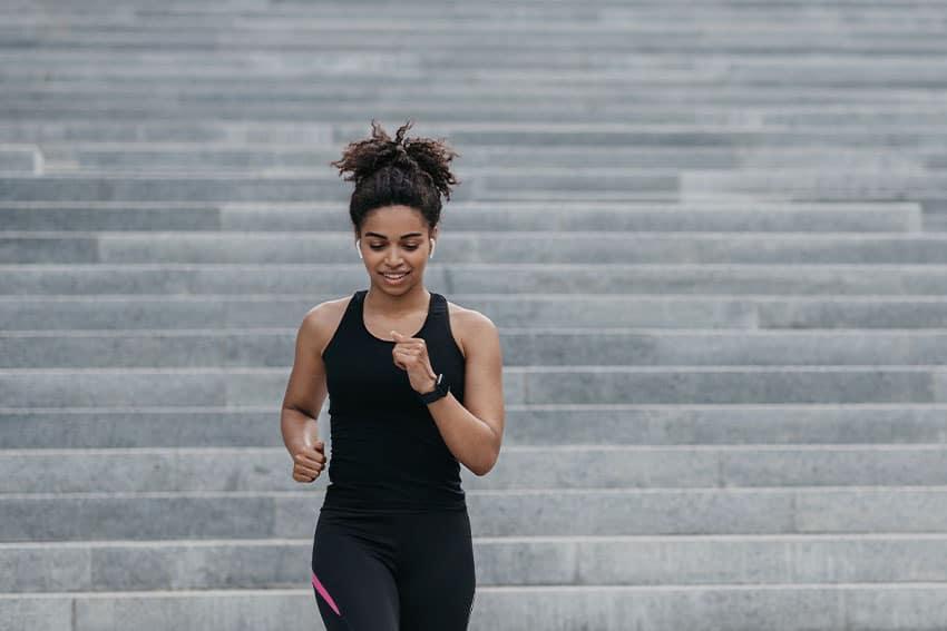 woman jogging down steps
