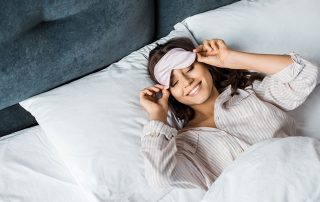happy young woman waking up from a great night's rest