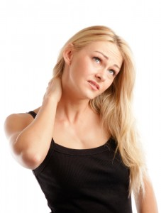 Blonde woman with a headache and neck stiffness.