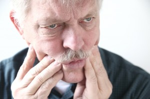 Older man with jaw pain
