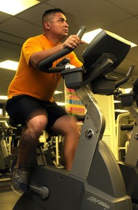 Man working out using a stationary bike